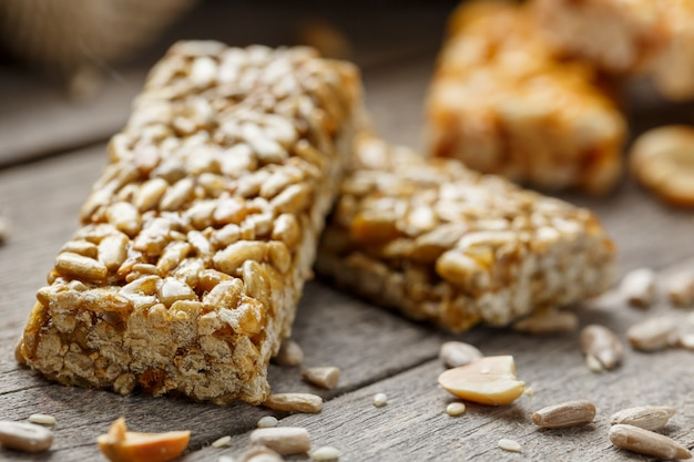 Casinac from sunflower seeds with burlap cloth. country style. delicious sweets from seeds of sunflower, sesame and peanuts, covered with shiny glaze Premium Photo