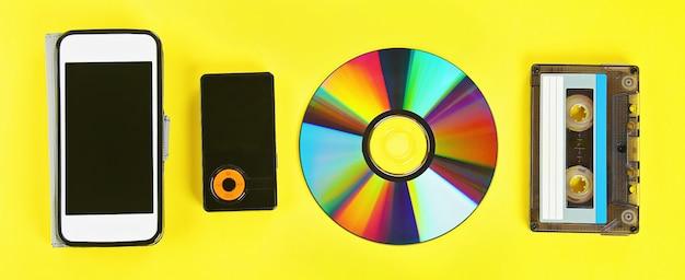 Cassette, cd-disk, mp3 player, mobile phone. Premium Photo