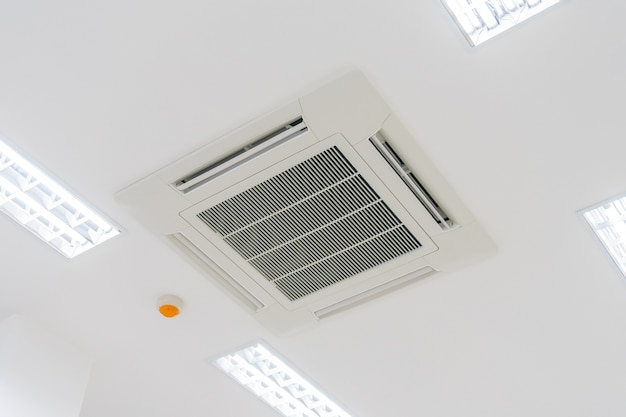 Cassette type air condition with lighting and fire protection system installation Premium Photo