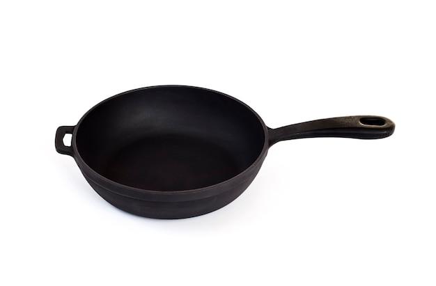 Cast iron pan with handle isolated Premium Photo