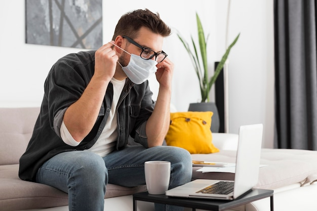Casual adult male wearing face mask at home Free Photo