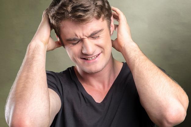 Casual caucasian  young man suffering from headache Premium Photo