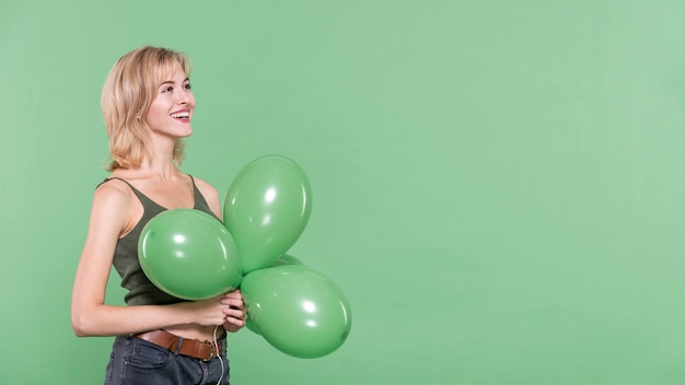 Casual dressed woman holding balloons Free Photo