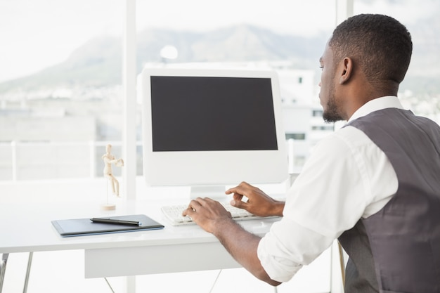 Casual man working at desk with computer and digitizer Premium Photo