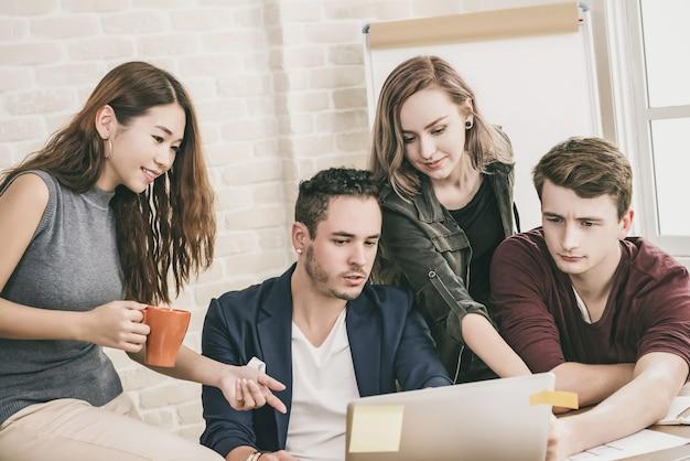 Casual office designer team discussing group work Premium Photo