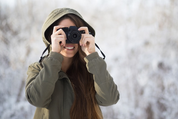 casual photographer taking forest outdoors Free Photo