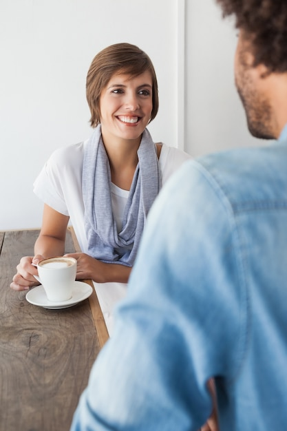 Casual woman having a coffee with friend Premium Photo