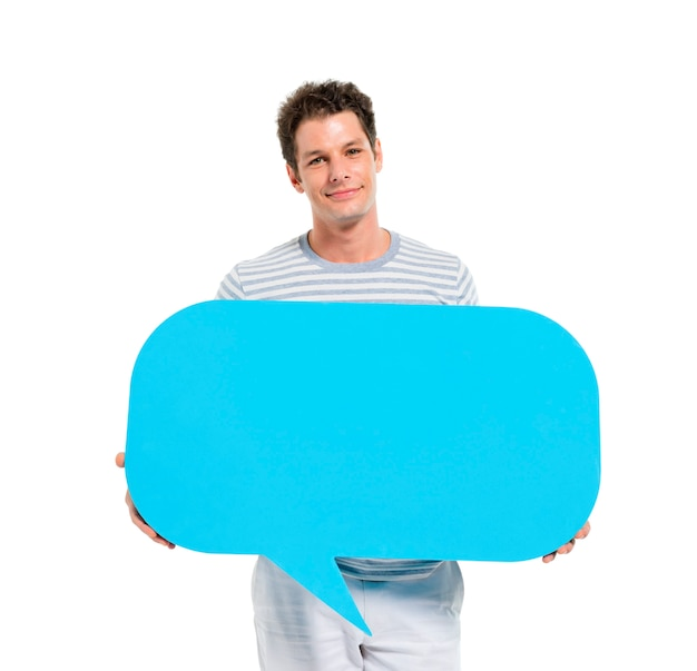 Casual young adult man holding speech bubble Free Photo