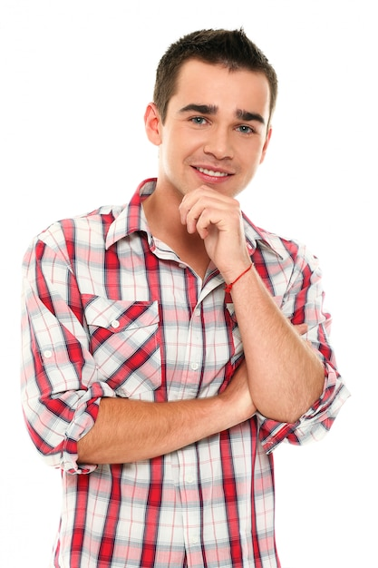 Casual young man posing with hand on chin Free Photo