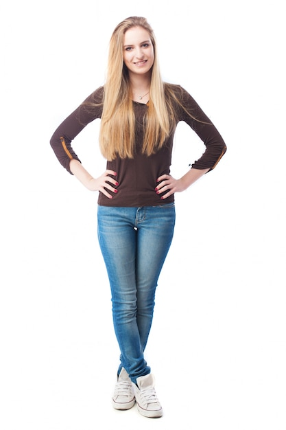 Casual young woman with hands on waist Free Photo
