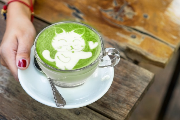 Cat cartoon on matcha green tea latte art Premium Photo