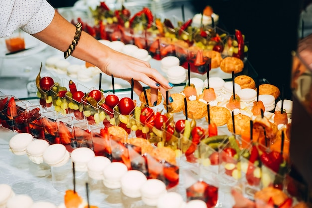 Catering services. buffet with sea food. canapes with red fish, shrimp sauce, small sandwiches. Premium Photo