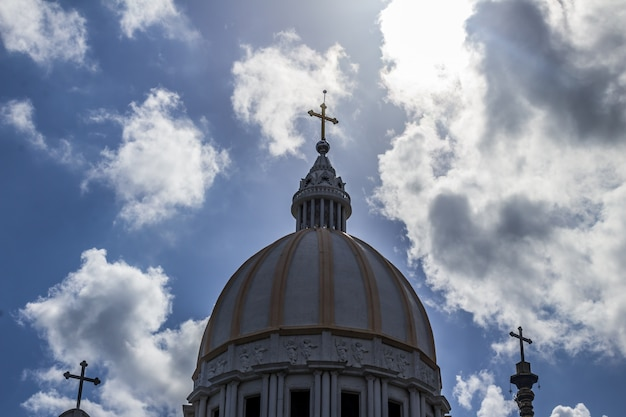 Catholic church with clouds in the background Free Photo