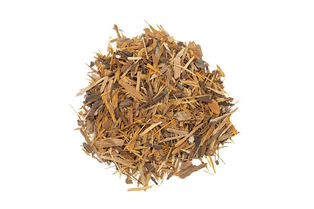Catuaba bark tea, isolated handful. natural herbal tea from powdered catuaba tree bark. Premium Photo