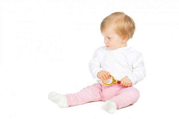 Caucasian baby girl holding magnifying glass isolated on white Premium Photo