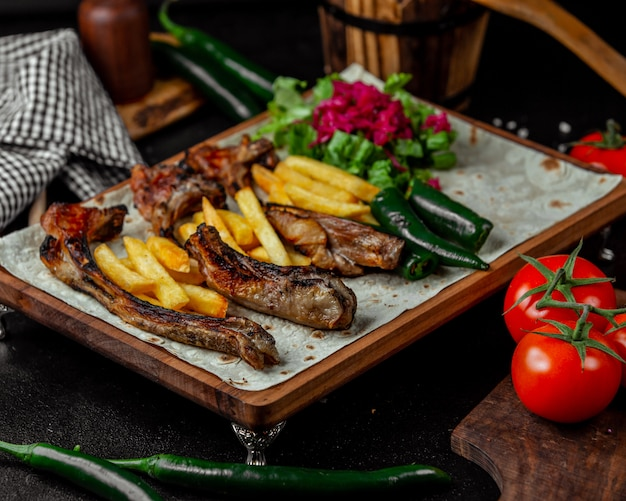 Caucasian barbecue with french fries in lavash bread. Free Photo