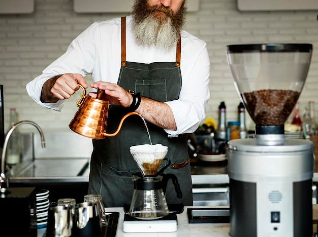 Pour water over coffee