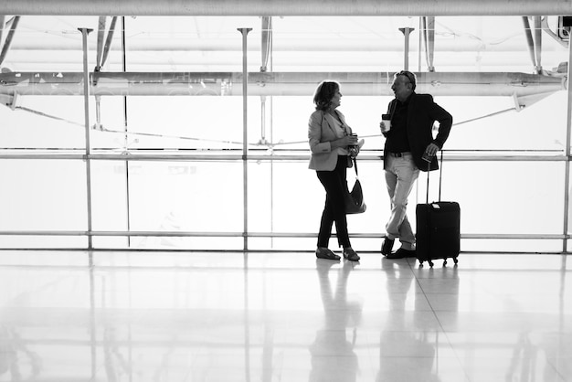 Caucasian couple talking together at the airport Free Photo