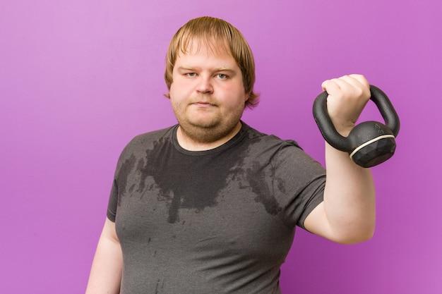 Caucasian crazy blond fat man sweating Premium Photo
