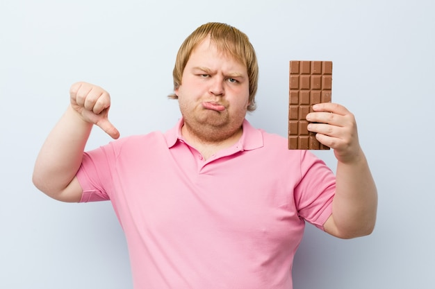 Caucasian crazy blond man holding a chocolate tablet Premium Photo