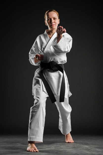 Caucasian fighter doing karate pose Free Photo