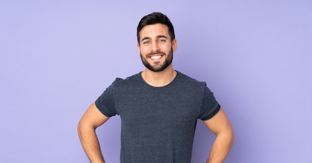2020 caucasian-handsome-man-posing-with-arms-hip-smiling-isolated-purple-wall_1368-89876.jpg