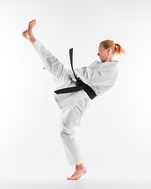 Caucasian karate fighter practicing full shot Free Photo