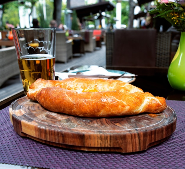 Caucasian khachapuri with a glass of beer in a restaurant Premium Photo