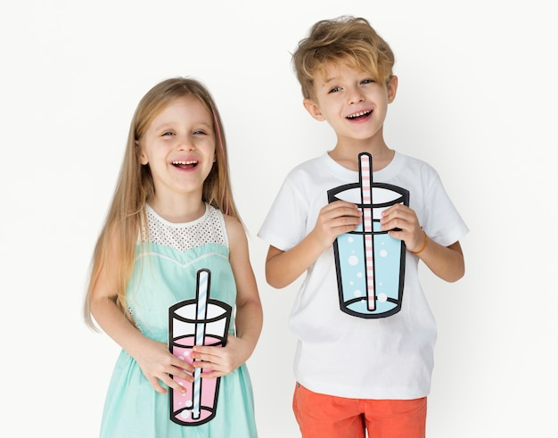 Caucasian kids holding paper drinking Free Photo