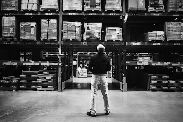 Caucasian man checking stock inventory Free Photo