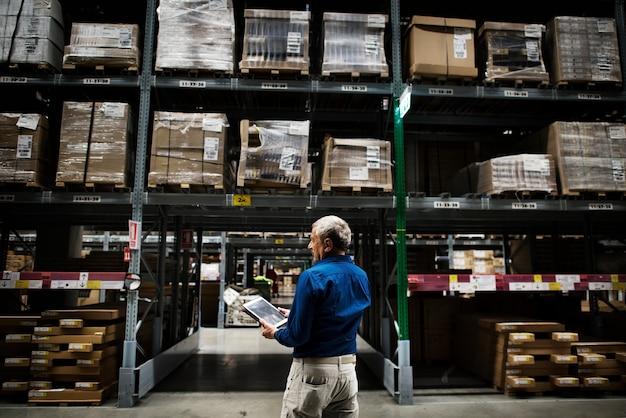 A caucasian man checking stock inventory Premium Photo