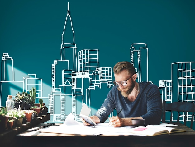 Caucasian man working with building illustration on green background Free Photo