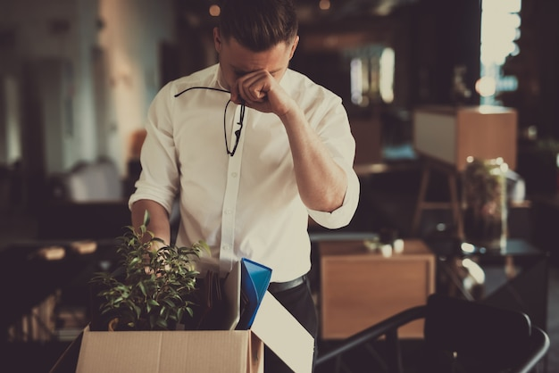 Caucasian manager leave workplace with office box Premium Photo