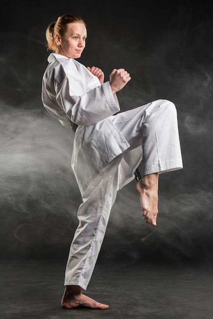 Caucasian martial arts fighter practicing Free Photo