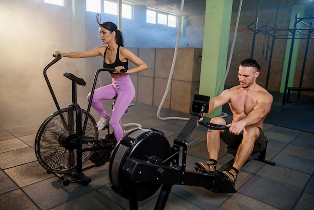Caucasian sport man and woman during training in the gym. Premium Photo