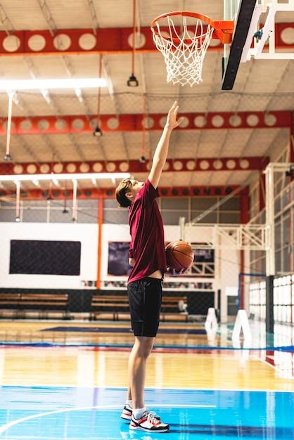 Caucasian teenage boy on a basketball goal and aim concept Premium Photo