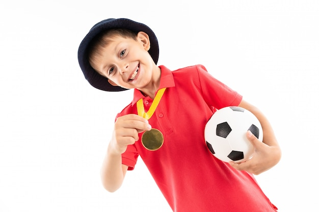 Caucasian teenager boy winner of soccer competition, picture isolated Premium Photo