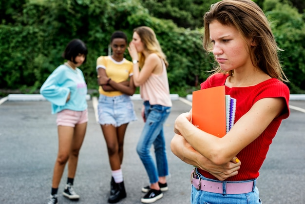 Caucasian woman being bullying from other girls Free Photo