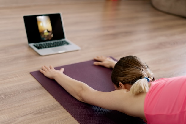 Caucasian woman practicing yoga at home Free Photo