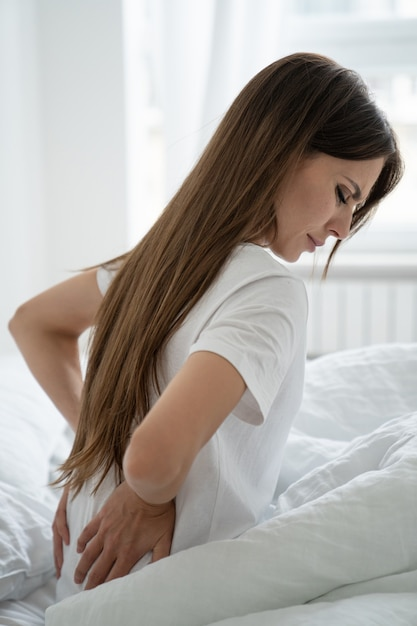Caucasian woman suffering from muscle back pain Premium Photo