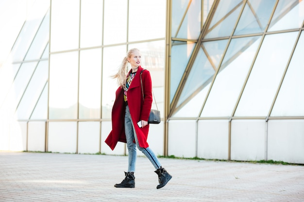 Caucasian woman walking outdoors Free Photo