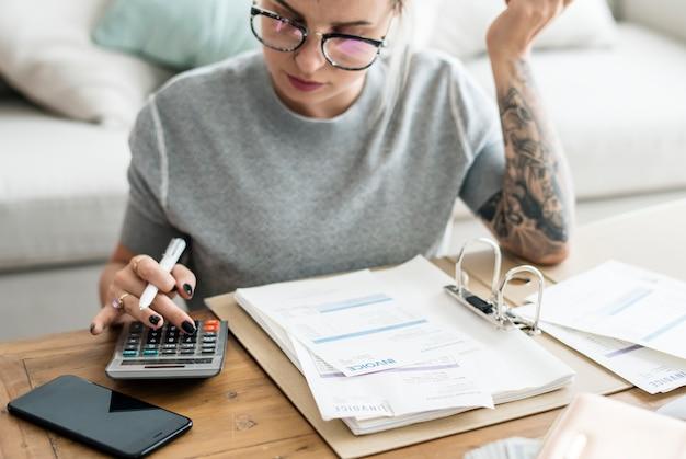 Caucasian woman with invoice bills Free Photo