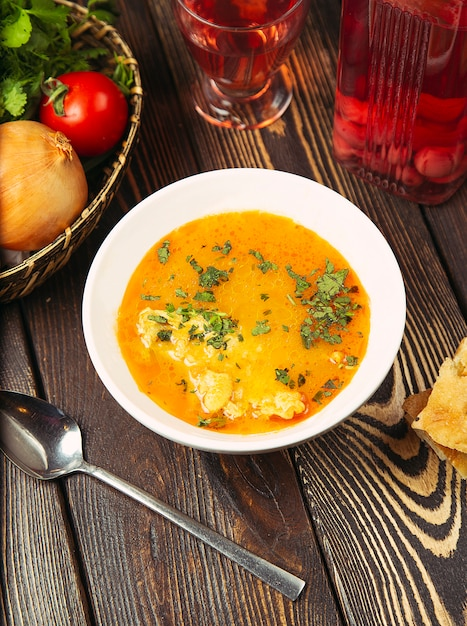 Cauliflower soup in chicken tomato broth with herbs. Free Photo