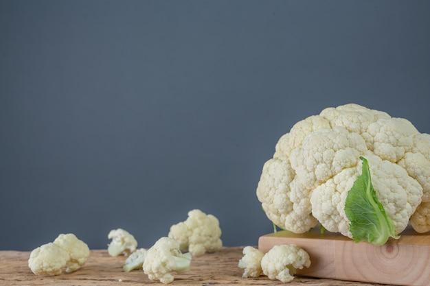 Cauliflower on the wooden floor. Free Photo