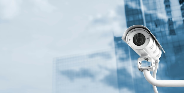 Cctv camera in the city with copy space Premium Photo