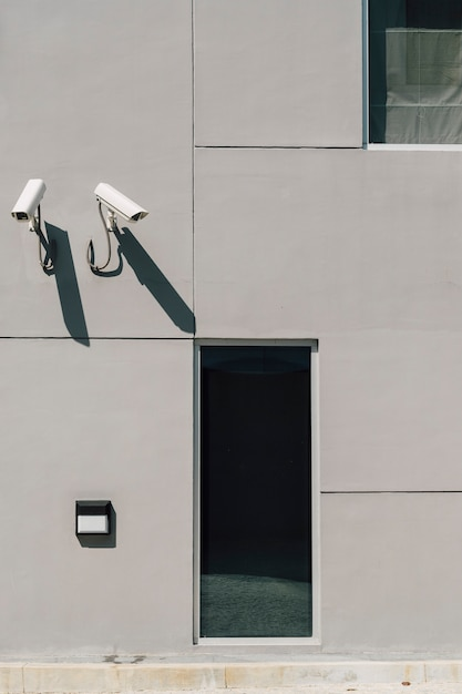Cctv camera in front of building Free Photo