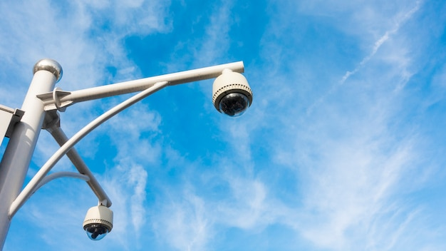Cctv camera with blue sky Premium Photo
