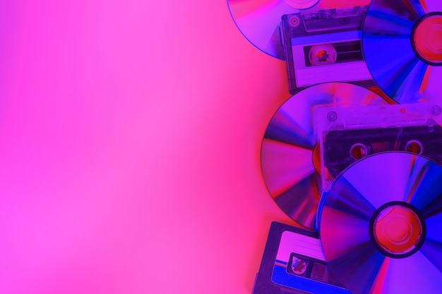 Cd disks and audio cassettes background Premium Photo