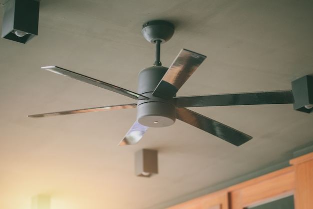 Ceiling fan in hot day cooling Premium Photo