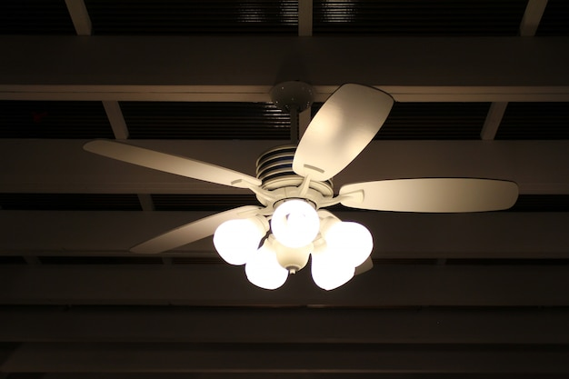 Ceiling fan and lamp on black background Premium Photo